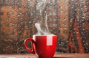 hot-coffee-red-coffee-cup-rainy-window-raindrops-buildings